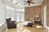 Family room with brick wall