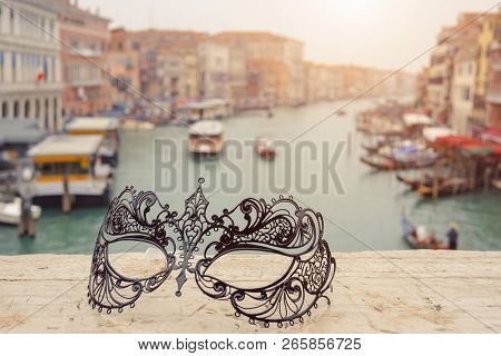 Venetian Masks On Bridge Agaist