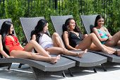 Group of girls laying out in the sun to get a tan poster
