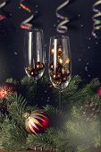 Close Up Glasses With Decoration And Champagne Bottle Wooden Background Christmas New Year Holidays  poster