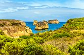 Small picturesque bay with azure ocean water. The Great Ocean Road of Australia. The Pacific ocean.  poster