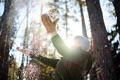 Joy Of A Winter Day. Woman In Winter Clothes Playing With Fresh Snow In The Forest On A Sunny Day, B poster