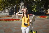 Young Beautiful Traveler Tourist Woman In Hat With Suitcase, City Map Retro Vintage Photo Camera Wal poster
