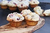 Cranberry Muffins With Lemon Sugar Topping On A Rustic Cutting Board With Loose Berries. Extreme Sha poster