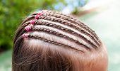 Thin Braids In African Style; French Braids On The Head Of A Little Girl poster