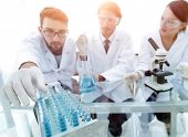 Portrait of a group of researchers conducting research poster