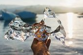Transparent Piece Of Ice Melting In A Hand In Jokulsarlon Lagoon, Iceland poster
