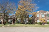 Bright Fall Foliage Color Outside Of Single Family Home In Texas, America poster