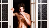 Guy Smooth Skin Posing Seductive. Beginning Great Evening. Man With Sexy Torso Drink Wine. Bachelor  poster