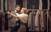 Man And Woman With Coats In Fur Shop. Money And Style Concept. Woman In Fur Coat With Bearded Man. D poster
