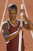 stock photo of pole-vault  - African American female pole vaulter holding pole - JPG