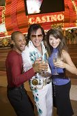 Interracial couple standing with Elvis impersonator