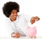 Black man saving money - isolated over a white background