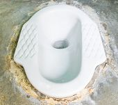 pic of septic  - Ceramic lavatory with septic tanks on cement floor - JPG