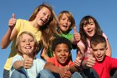 stock photo of tween  - group of diverse kids or children with thumbs up - JPG