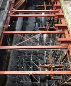 foto of girder  - A large underground construction site with strong pillars and girders - JPG