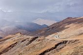 pic of manali-leh road  - Road in Himalayas in clouds near Tanglang la Pass   - JPG