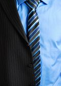 image of partially clothed  - This is a an image of business man wearing a tie shirt and a partially worn suit - JPG