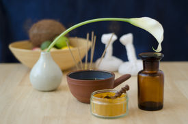 foto of vedic  - A table top arrangement of spice oil and massaging tools used in Ayurveda massage - JPG