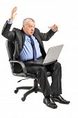pic of outrageous  - Shocked businessman having problems with his laptop isolated on white background - JPG