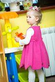 picture of montessori school  - Little child girl playing in kindergarten in Montessori preschool Class - JPG
