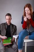 picture of teen smoking  - Vertical view of a problematic teenagers smoking cigarette and texting in classroom - JPG