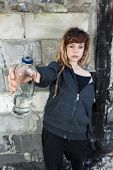 picture of rap-girl  - Young girl with bottle of vodka vertical - JPG