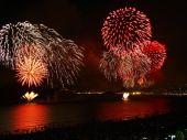stock photo of reveillon  - beautiful fireworks celebrating new year on the beach - JPG