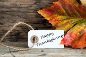 image of happy thanksgiving  - Happy Thanksgiving on a Autumn Background Label - JPG