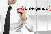 stock photo of defibrillator  - doctor with necktie drawing heartbeat line emergency - JPG