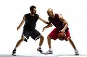 foto of basketball  - Isolated on white  two basketball players in action - JPG