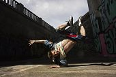 image of  dancer  - Hip hop dancer is dancing on the street - JPG