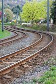 stock photo of tram  - Curved rusty tram rails  - JPG