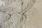 stock photo of concrete pouring  - Close up wet concrete floor pouring in construction site - JPG