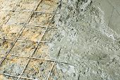 picture of concrete pouring  - Close up wire mesh and wet cement in concrete floor pouring process - JPG
