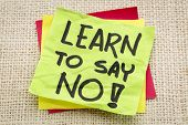 pic of canvas  - learn to say no advice or reminder on a green sticky note against burlap canvas - JPG