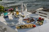 picture of ouzo  - seafoods on the dinner table at the beach - JPG