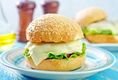 stock photo of bap  - cheese burger on plate and on a table - JPG
