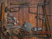 pic of work bench  - vintage jeweler tools and diamonds over wooden working bench - JPG