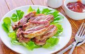 stock photo of shoulder-blade  - fried meat on white plate and on a table - JPG