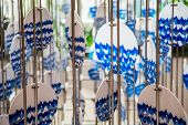 foto of chimes  - A blue and white wind chime with ocean or sea graphic - JPG