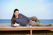 picture of booty  - pregnant woman on the beach with paper boat and striped booties - JPG