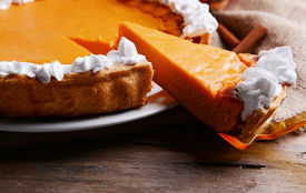 pic of pumpkin pie  - Composition of homemade pumpkin pie on plate and fresh pumpkins on wooden background - JPG
