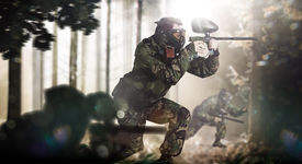 foto of paintball  - Paintball team in action rainy forest location - JPG