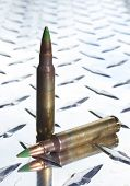 pic of cartridge  - Rifle cartridges with bullets that have steel tips on a chrome plate  - JPG