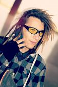 foto of rasta  - portrait of young guy with rasta hair in a lifestyle concept warm filter applied - JPG