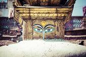 picture of shankar  - Buddha eyes close up with prayer flags at Bodhnath stupa in Kathmandu valley Nepal - JPG
