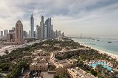 stock photo of dubai  - Dubai Marina Skyscrapers and Arabian Gulf Coast in Dubai United Arab Emirates  - JPG