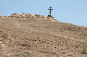 picture of cross hill  - wooden cross on a lifeless dry hill - JPG