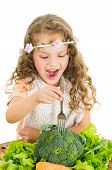 image of healthy eating girl  - Beautiful healthy little curly girl enjoying eating broccoli isolated on white - JPG